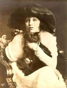 """Bebe Daniels & cat  """" Jailed for driving over 50 miles an hour, she spends ten days in a Santa Ana jail. One day Abe Lyman and his Coconut Grove Orchestra serenade her outside her cell with the 'Rose Room Tango', a specialty number she danced with Rudy Valentino."""""""