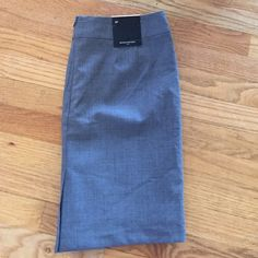 Banana Republic gray 8p Brand-new with tags. Gray suit-pencil skirt from banana republic. Zip back.  68% wool 29% polyester 3% spandex. Approx 18 inches from waist.  Petite sizing. Banana Republic Skirts
