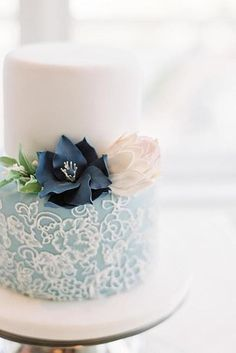 This intricate floral piping on blue fondant. | 27 Strikingly Beautiful Wedding Cake Details