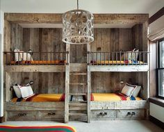 Rustic country bunk room features built-in barnwood bunk beds dressed in yellow bedding flanking a rustic bunk bed ladder illuminated by a wood geometric drum pendant. (Cool Rooms With Bunk Beds) Home, Rustic Bunk Beds, Bunk Beds Built In, Yellow Bedding, Cottage Bedroom, Country Boys Rooms, Loft Spaces, Remodel Bedroom, Home Decor
