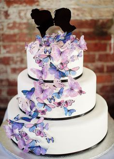 The cascading butterfly accent on this cake makes our heart flutter. Wedding Cakes, Wedding Cake Designs, Cake Decoration