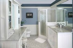Blue and white is a classic color scheme for a master bath. Love the marble counters and marble tile floor.