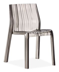 The Ruffle dining chair combines the elegance and modernity of polycarbonate body, a sensuous shape that is stackable, and has UV protection for outdoor use. www.ProjectDecor.com