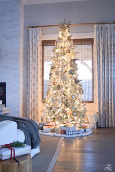 Holiday Home Showcase - white and gold flocked tree. Christmas tree at night
