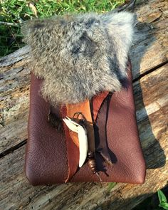 A personal favorite from my Etsy shop https://www.etsy.com/listing/247345942/handmade-leatherrabbit-fur-pouch-purse