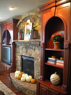Just change the colour of wood. Stone fireplace with built-in shelves - rustic and elegant Fireplace Built Ins, Home Fireplace, Living Room With Fireplace, Fireplace Design, Home Living Room, Fireplace Ideas, My Home Design, House Design, Family Room Design