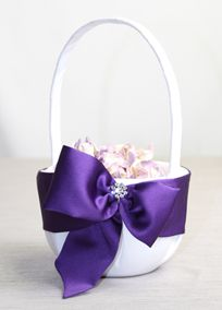 """Davids Bridal Exclusive flower girl basket featuring a bold satin modern bow topped with a rhinestone brooch that is wrapped around this basket beautifully creating a sophisticated and luxurious look. * Accent ribboncolor is Regency.  Measures 11"""" tall.  -- @Jewelyn Wellborn"""