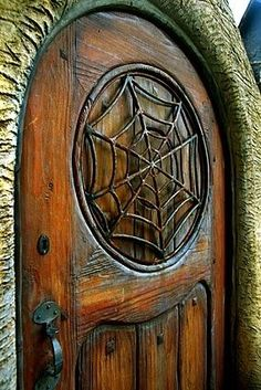 Door with round top and wrought iron spider web window detail