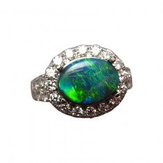 A beautiful Opal and Diamond ring in 14k Gold with a Black Opal set oblong and accented with quality Diamonds.