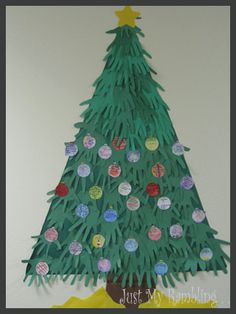 This would be a great craft for a preschool classroom bulletin board or at home. I also thought it would be fun  to have a large family all draw their hands and make a Christmas tree together.