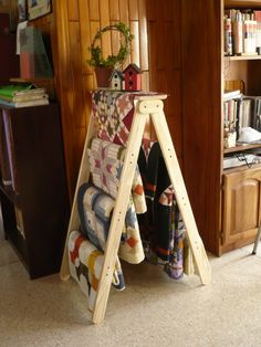 Quilt ladder - a clever way to display quilts! I am thinking Skip needs to make me one of these!