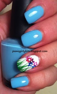 flowers in the grass with blue. i dont paint my nails but this is adorable.