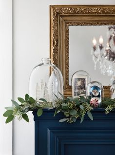 Dried Eucalyptus Garland   Mother Nature's fragrances are especially appealing this time of year, and eucalyptus is no exception. Create your own series of scented snow globe-esque displays by encasing bottlebrush trees, vintage ornaments and treasured cards under glass cloches.