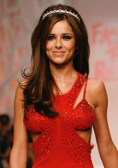 Adding a pop of colour, Cheryl Cole's crown-shaped sequinned headpiece features vibrant red stones that complement the singer's runway gown Cheryl Stone, Cheryl Cole Style, Cheryl Ann Tweedy, Nicola Roberts, Elizabeth Hurley, Inspirational Celebrities, Down Hairstyles, Wedding Hairstyles, Pretty Woman