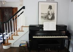 As an apartment dweller, I've always envied those lucky ducks that have room for a piano. Spotting one in a home makes me think of carols at the holidays and after-school lessons — scales and Für Elise echoing throughout the house. But just how does one decorate around such a bulky and attention-grabbing instrument? These 15 great examples from our house tours show how to do it right.