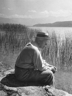 Carl Jung Sitting on Stone Wall Overlooking Lake Zurich. Photo by Dmitri Kessel. Carl Jung, Gustav Jung, Turn To Stone, Hermann Hesse, Artist Life, Archetypes, Belle Photo, Quotations, Einstein
