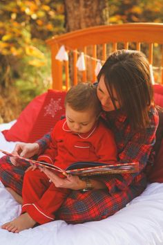 Little boy and mom snuggle in bed while wearing red pajama sets for holiday styled shoot by Amanda Sutton Photography | Two Bright Lights :: Blog
