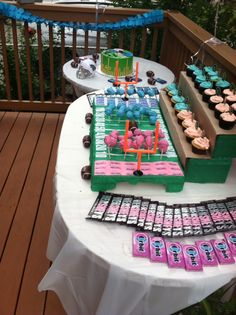 Gender reveal - football theme dessert table! A football field was created with styrofoam and streamers for the football shaped cakepops Bleachers were made out of cardboard for the cupcakes Cupcakes had a football wrapper and an I love football topper Hershey bars were genderized using nail polish Packs of orbit gum used for more color emphasis There was also blue raspberry and pink lemonade in 2 beverage dispensers All tables had a football field runner in the middle