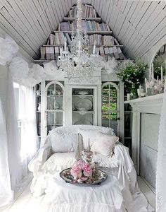 I love everything from the chandelier to the big windows to the way the books are stored