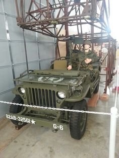 "Airborne jeep with glider framework with the 325th glider infantry regiment label on the bumper ""Let's Go!"""
