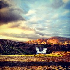 Sunset over a waterfall in Iceland