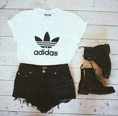 Adidas top with black cut-off jeans and black boots.
