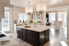 Beautiful kitchen.  I love the chandeliers, but I don't think those shades would hold up very well in a kitchen.