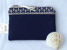 Women's Nautical Fabric Wallet Zipper Purse Credit Card Holder. Quality handmade FABRIC ZIPPER PURSE designed with premium quilt shop mini fish fabrics. This small fabric wallet has been created with fleece interfacing to hold its shape and also with woven interfacing for strength and durability. Inside is a divided section to keep money and ID's separate. Wallet has a zipper closure, too. Outside has Kam snap on a 3/4 high pocket with cutest little red fish swimming around. This nautical...