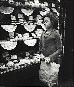 A child stares into a bakery window in Whitechapel, London (circa 1935) photo by Edith Tudor-Hart..: