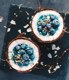 Fresh coconut filled with a mixture of blended pear, coconut milk, blue spirulina and water (this combination is ) and topped with frozen blueberries, cacao nibs, coconut chips and popped quinoa