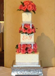 Coral roses square wedding cake. Buttercream with rhinestone ribbon and pearl accents