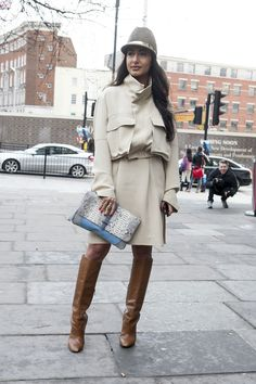 LFW Street Style Day Four: Nausheen Shah channeled a sexy '70s vibe in a silky trench and knee-high boots and carried an exotic clutch.