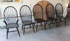 These Windsor Chairs are part of an 8 chair set.They are originally from the Old Crawford Furniture Factory that was located in Jamestown New York. They have been completed in General Finishes Lamp Black and then top coated with a 50/50 mix of Enduro satin and flat which created a more matte finish. They were then hand rubbed with rubbing wool.