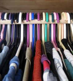 Declutter your closet by turning the hangers backwards at the beginning of the season. If its still backwards at the end of the season, donate it!...good idea!