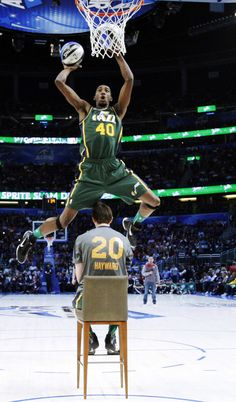 Utah Jazz's Jeremy Evans jumps over teammate Gordon Hayward during the NBA basketball All-Star Slam Dunk Contest in Orlando, Fla., Saturday, Feb. 25, 2012.