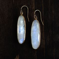 Eye catching moonstones are bezeled in 24k gold, these drops glow in any light.  Ear wires are gold fill. Photography by Gurvitch Images.