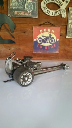 Up-cycled dragster from Railroad spike,Pipe wrench,Skateboard wheels,Smooth round rods.Constructed  by Ray Gilliam