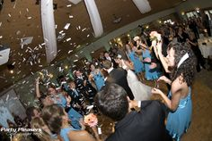 Confetti shot after introductions. Ceiling swags over dance floor  Photo Credit- Kim Greer  #CincinnatiWedding #PartyPleasers #ConfettiShot #CeilingSwag