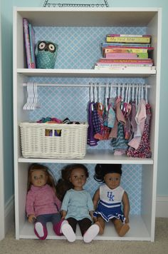Doll Storage. $20 bookshelf from Target, add tension rod for hanging doll clothes (hangers from Amazon). Add cute contact paper to the back BEFORE nailing it to the bookshelf.