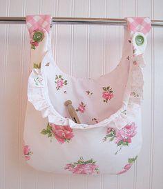 new CLOTHESPIN BAG ruffles VINTAGE pink roses fabrics shabby chic laundry holder pegbag cottage. $26.95, via Etsy.