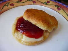 Picture of Wild Plum Jam with a delicious biscuit or scones.