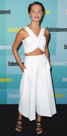 Alicia Vikander epitomized effortless-chic at the Entertainment Weekly Comic-Con party in an optic white Rosetta Getty design featuring clean lines and modern silhouettes by way of a crossover crop top and billowing wide-leg culottes. Monica Vinader jewelry and black strappy sandals rounded out her look.