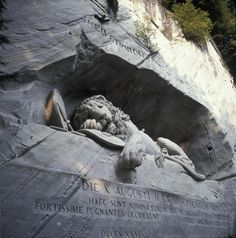 Lion Monument «The dying Lion of Lucerne» is one of the world's most famous monuments.  It was carved out of natural rock in memory of the heroic deaths of the Swiss mercenaries at the Tuileries in 1792. Mark Twain described the Lion of Lucerne as the saddest and most moving piece of rock in the world.