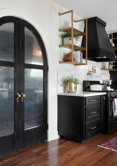 The antique doors leading into the pantry helped bring architectural details to a formerly basic space and offered a nice contrast to the white color we chose for the walls.