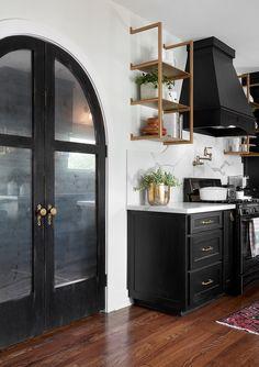 Black kitchen and that door!