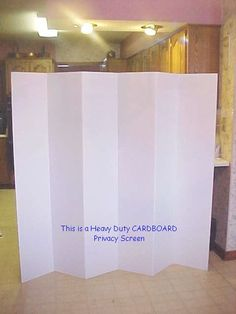 Cardboard Room Divider - $34 + shipping - paintable (blackboard?) - weighs 6 pounds, so fine to hang on wall with 3m command strips - could glue corkboard sheets to it