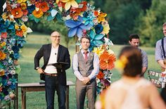 Check out that paper flower arch. Wow!