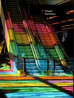 Rainbow stairs in the rainbow hued building, Palais de Congrès de Montréal in Canada.