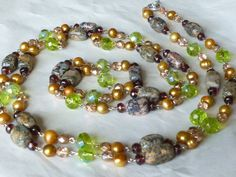 Long Strand Beaded Statement Necklace with Unakite, Gold Freshwater Pearls, and Peridot Green Cezh Crystals by Margica,   $104.00 Length: 55 inches long