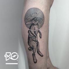geometric linework rabbit leg tattoo idea